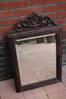 Garden mirror with an ornate bronze-coloured metal bezel.