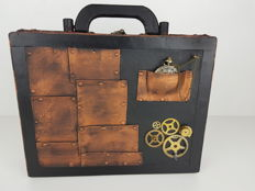 Steampunk wooden suitcase with functioning clock