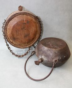 Cast iron and wooden antique field bottles, World War I - late 19th century