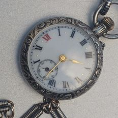 Silver 925 pocket watch on a silver 800 Nillo chain.