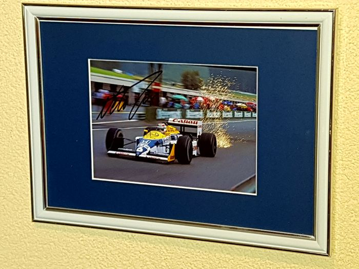 Nelson Piquet Snr. - 3-time world champion Formula 1 - original autographed framed photo F1 + COA.