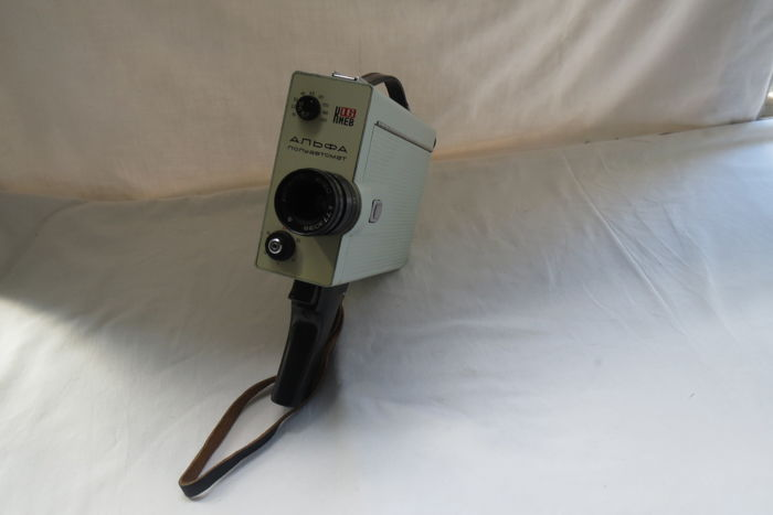 "The ""Kiev-16 Alpha-Semiautomatic"" movie camera was produced by the Kiev Automation Plant named after V.Sh. GI Petrovsky (KZAP) from 1972-1979. Cinema film is 16mm.The ""Vega-7E"" lens (f = 2/20) -Lytkarino LZOS, allows to shoot with sufficient sharpness in"