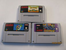 3  Super Nes Games. , Super mario all stars /  Super mario world, Super Ghouls 'n Ghosts and exta an other Super mario world.