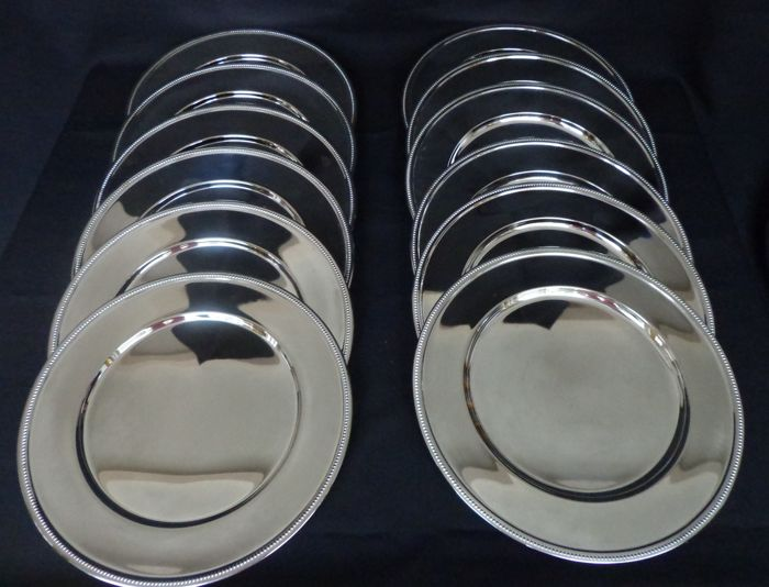 Set of 12 silver plated under plates with pearl rim