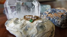 Yellow gold ring set with natural emerald and zircon stones