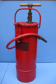 Antique fire extinguisher with a hand pump