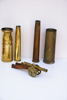 4 Copper cannon gun shells, WWII and a bronze replica cannon.