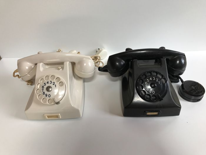 Authentic black and white Bakelite telephone.