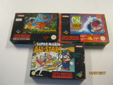3 boxed Super Nes games like: Jungle book,spot and Super mario all stars