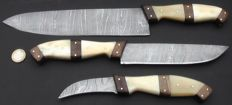 Set of three handcrafted Damask knives: 1 very long / wide chef's knife, 1 medium long chef's knife, 1 peeling chef's knife - 200+ layers damask steel -handle made out of camel bone and wood