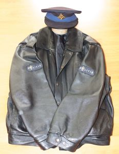 Old heavy leather police jacket and hat - The Netherlands - late 20th century
