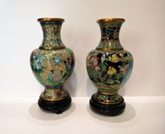 Two Chinese multicolored cloisonne vases οn wooden bases - China - second half of the 20th century.