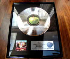 """Presented to The Beatles """"Sgt Peppers Lonley hearts club band"""" Apple  sales award"""