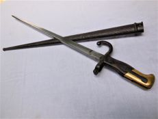 Antique Epee Bayonet Mle 1874 with a sheath, hallmarks, and engraving on the back of the blade