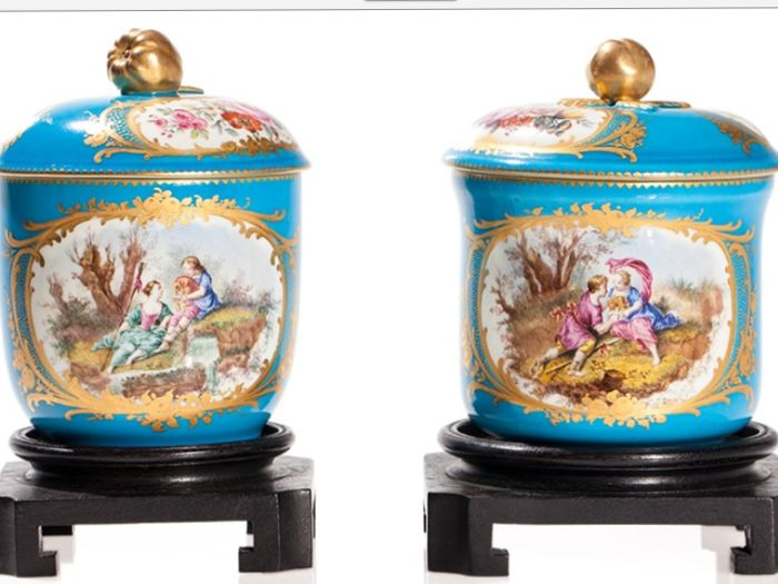 A pair of Sevres style containers with lids