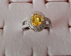 Hand-made 18 kt white gold ring, with1.85 ct central yellow sapphire and 1 ct of G-VS diamonds, size 13