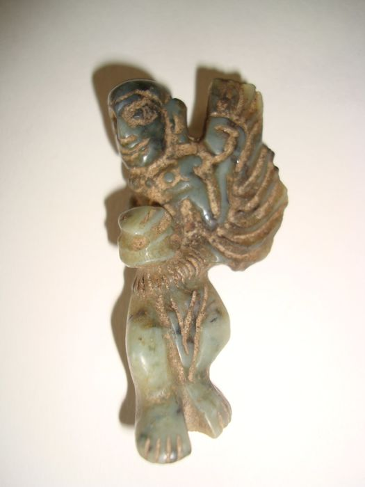 A jade talisman in form of a protecting deity - 57 mm