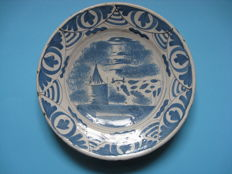 A blue and white majolica plate, Friesland or Delft, 1700-1750