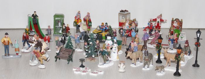 45 Lemax Christmas figurines for a Christmas village