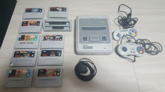 Super Nintendo SNES  incl 9 games like: Donkey Kong country 1 , 2 and more