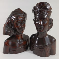 Wood-carved bust of man and woman – Bali – Indonesia – mid 20th century