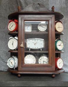 Oak Pan box with collection of nostalgic alarm clocks