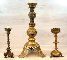 Three antique church candlesticks