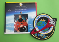 Collection of coins in honour of Dirk Frimout + STS-45 mission patch