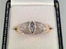 Yellow and white gold ring with aquamarine and diamond