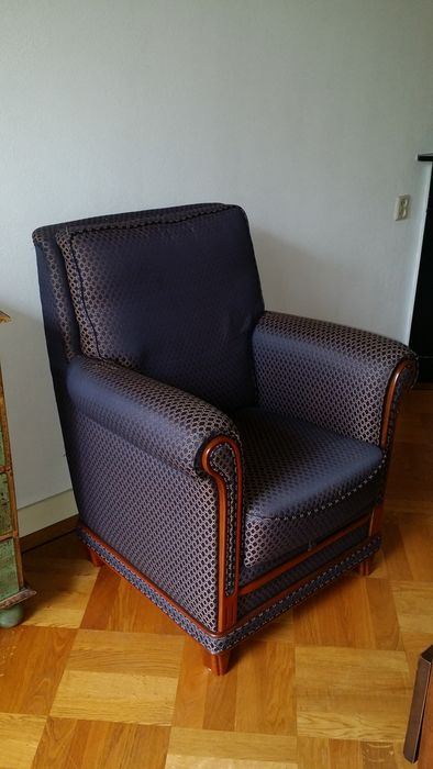 A padded armchair, made in Italy, recent
