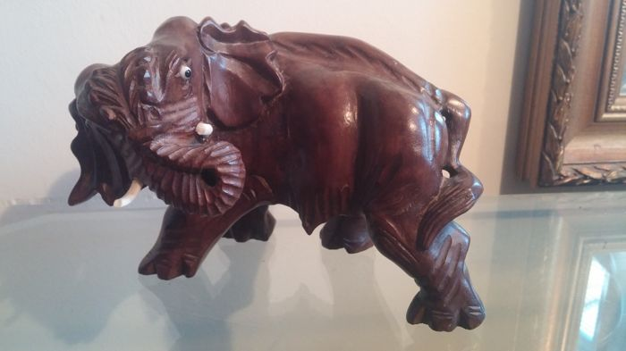 African wooden sculpture of a wild elephant