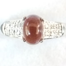 Unusual and Rare 1.226cts Brazillian Cats Eye Scapolite with Si Diamonds in white gold Dress ring.