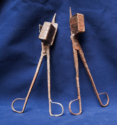 Two 17th century iron candle snuffers
