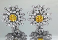 18 kt Gold earrings set with 2 fancy intense deep yellowish orangey diamonds, 1.70 ct & white diamonds, total 3.50 ct