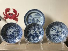 Blue and white plate and three saucers - China - 18th century
