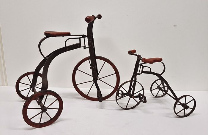 Two wrought iron tricycles, France, 20th century