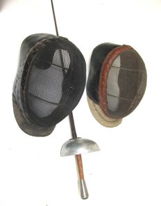 Two old fencing masks and sword