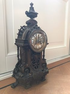 French bronze mantel clock with a dial with enamel cartouches - Period 1880-1890