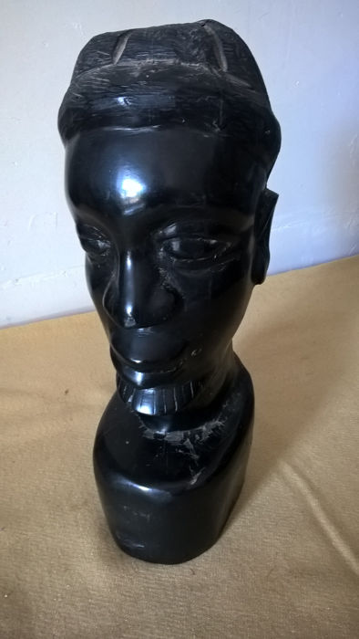 Genuine ebony bust.