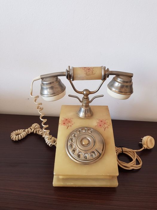 Elegant vintage phone from the 60s - red floral decorations - brass