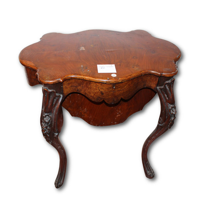 Burr walnut work table with maple inner part from the first half of the 19th century.
