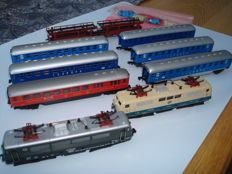 Arnold/Lima N - 2 locs BR111 + 6 express-train wagons + car transporter with loose cars of the DB
