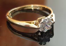Engagement ring made of platinum and 18 kt gold