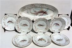 Limoges fish tableware set for eight people, marked 'G.D.&C -  Limoges'