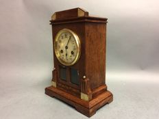 Art Nouveau wooden mantel clock with striking mechanism