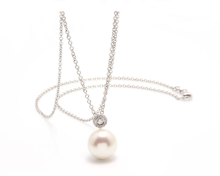 Pearl and Diamond Pendant Featuring a  Freshwater Pearl 11-12 mm paired with a Beautiful Diamond Circle