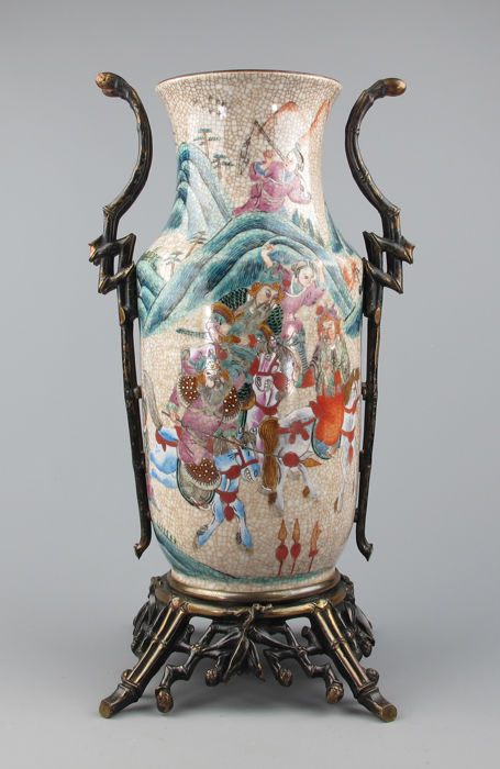 Porcelain baluster vase, polychrome painted images with figures, brass bamboo frame – China – late 19th century