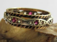 Gold eternity ring with natural 14x diamonds and 7x rubies