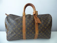 Authentic Louis Vuitton Keepall 45 – Louis Vuitton travel bag.