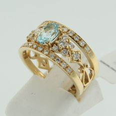 IGI-certified yellow gold fixed with a blue topaz and brilliant diamonds